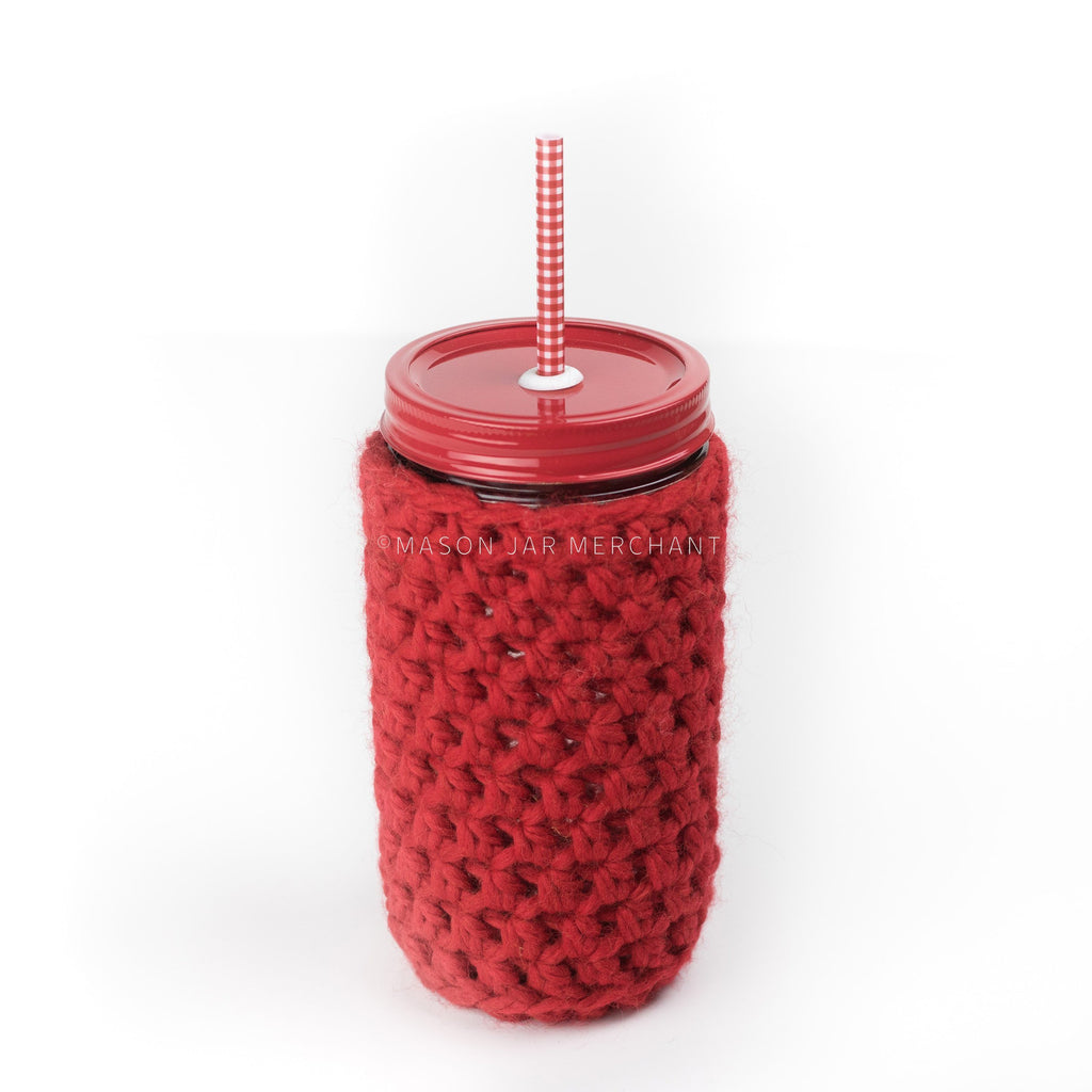 24 oz reusable glass mason jar tumbler with all red straw lid and a red and white gingham reusable straw. A red knit cozy covers the jar