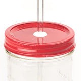 Close-up of a 24 oz wide mouth mason jar with a custom painted red lid with white silicone grommet and a glass straw, against a white background