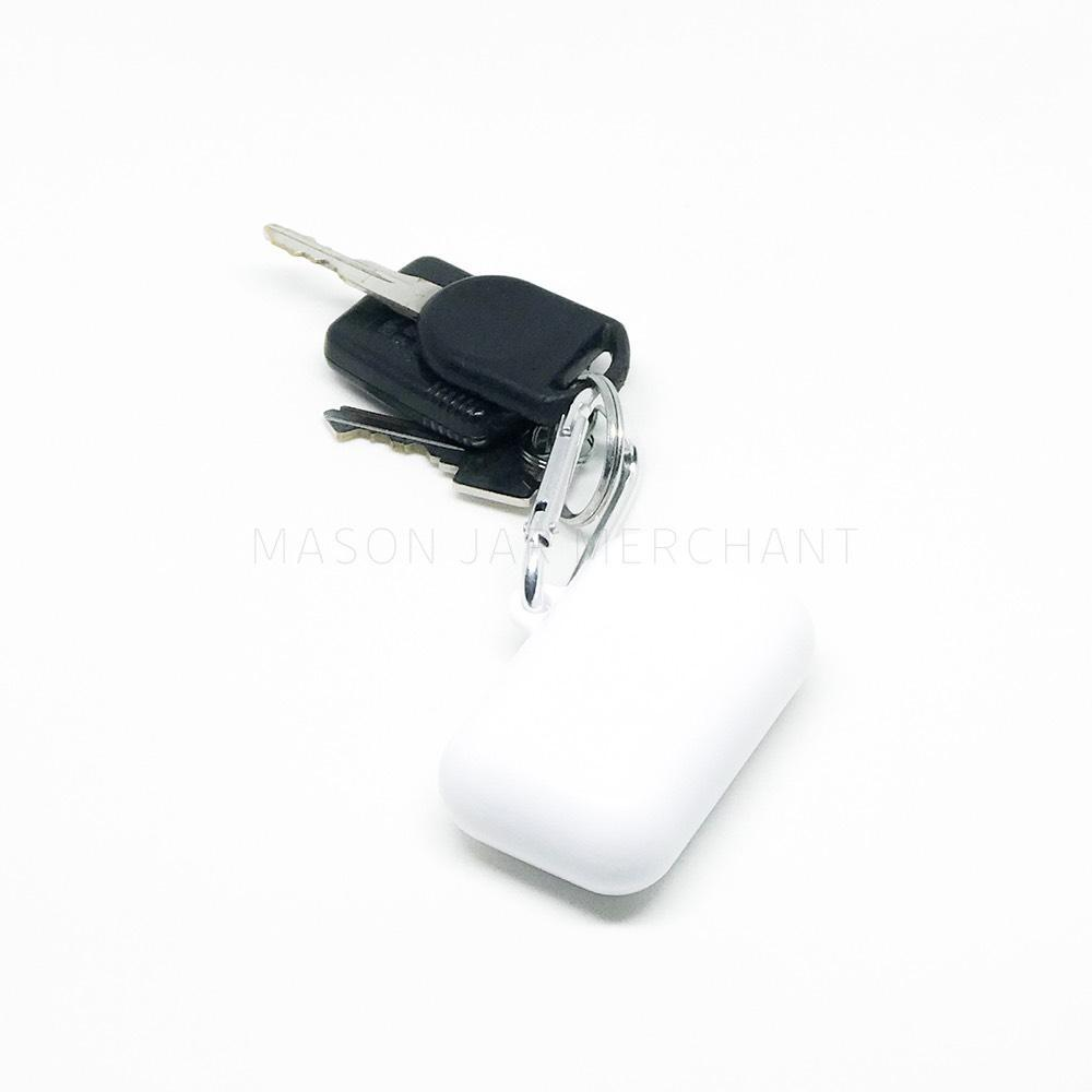 white collapsible reusable straw keychain attached to a car key