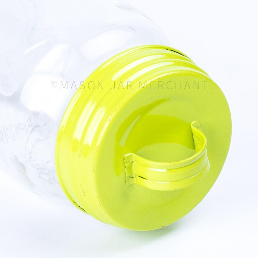 Chartreuse vintage look enamel mason jar lid shown on a white background.