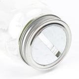 Mason Jar Coin slot Lid shown on a regular mouth mason jar on a white background