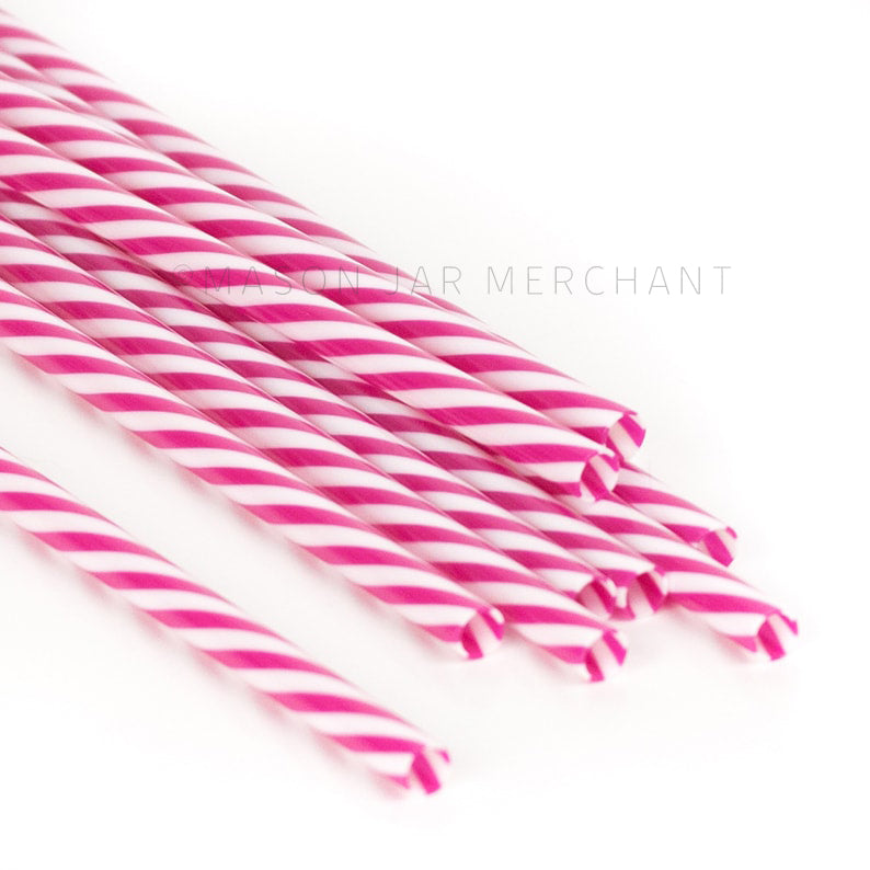 Dark pink and white striped BPA-free reusable plastic straws against a white background