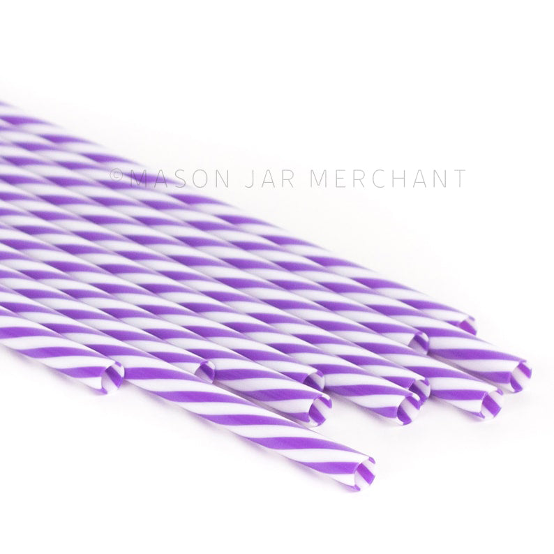 Purple and white striped BPA-free reusable plastic straws against a white background