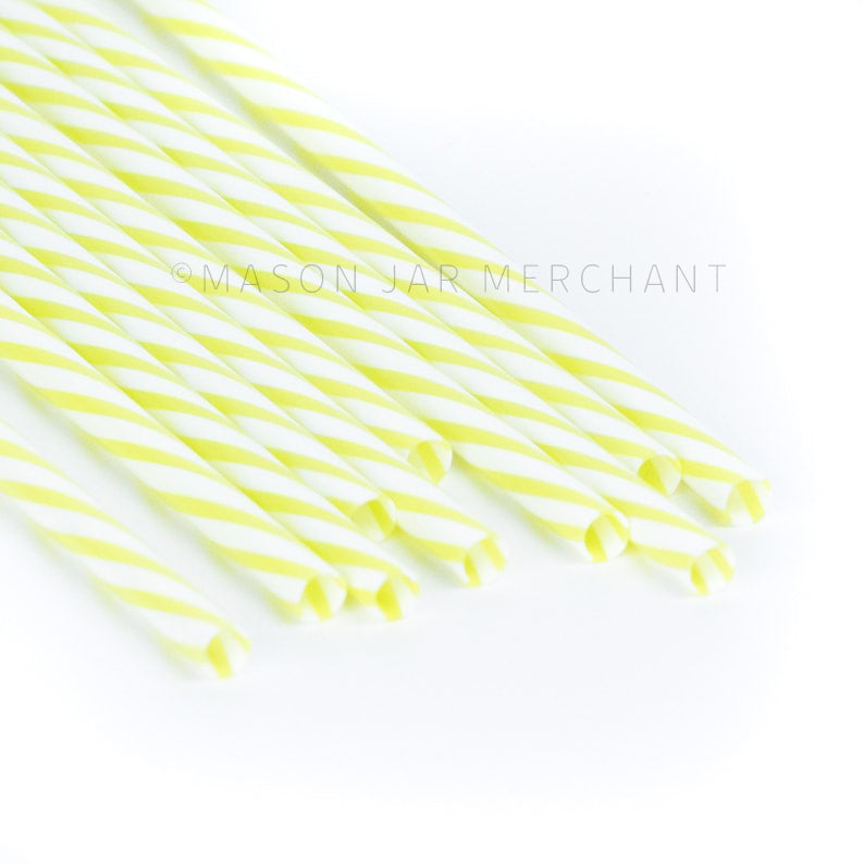 Yellow and white striped BPA-free reusable plastic straws against a white background