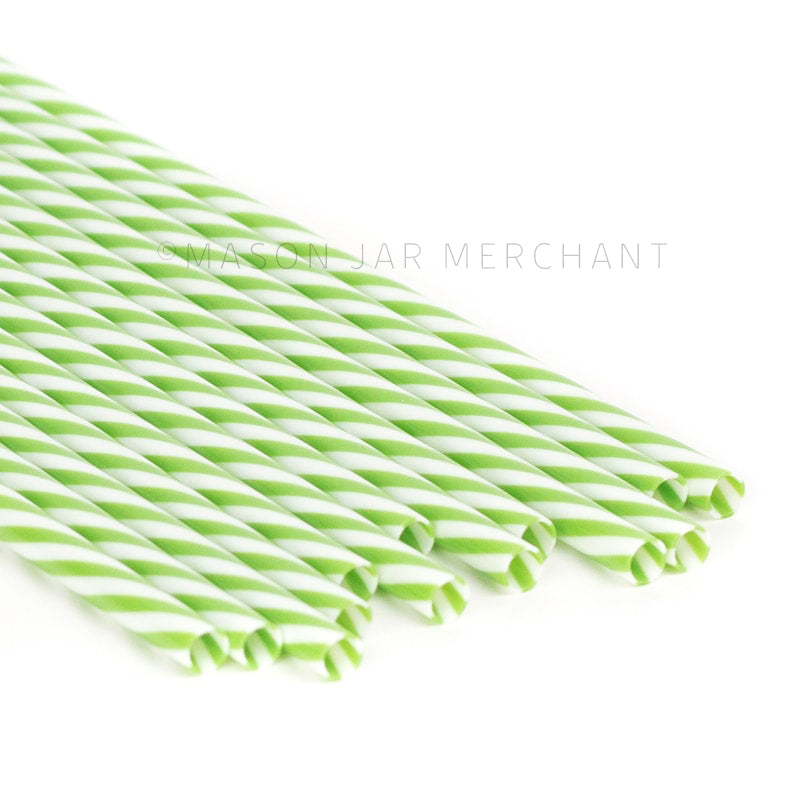 Green and white striped BPA-free reusable plastic straws against a white background