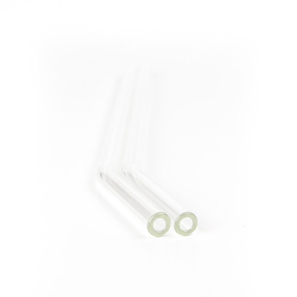 close up of two bent reusable glass straws on a white background