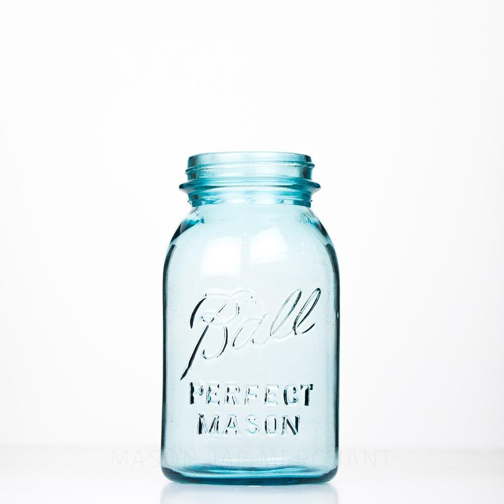 Vintage blue Ball regular mouth quart mason jar against a white background