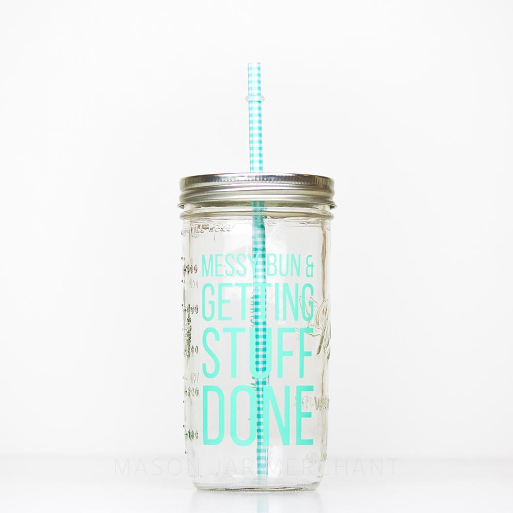 "24 oz reusable glass mason jar tumbler with a silver straw lid and a aqua and white gingham reusable straw. On the jar are the words ""Messy bun & Getting Stuff Done"" in aqua  block text"