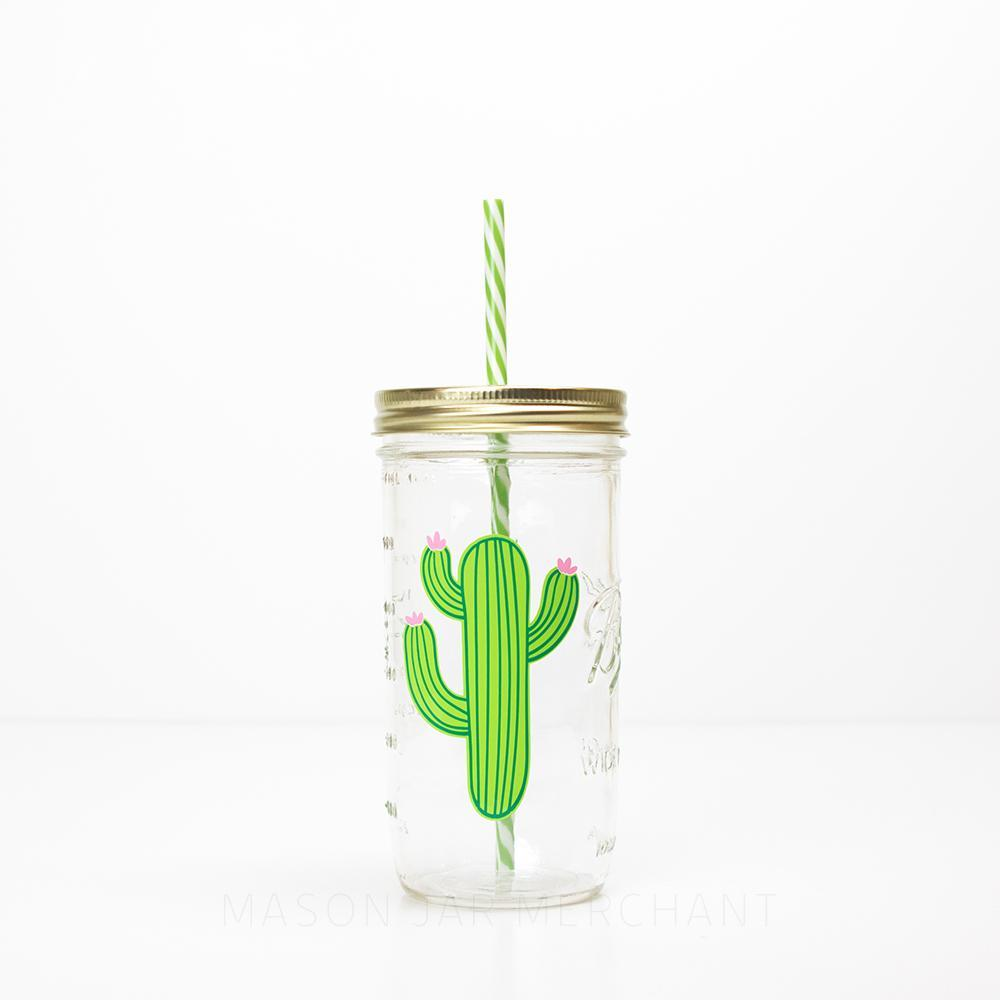 green cactus with pink flowers on a reusable glass tumbler with straw