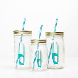 blue and white surfboard design on a reusable glass water bottle with straw in multiple sizes