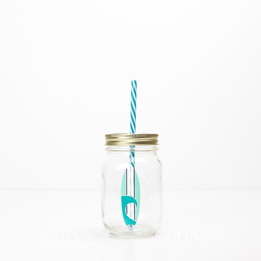 blue and white surfboard design on a reusable glass water bottle with straw 16 oz