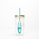 blue and white surfboard design on a reusable glass water bottle with straw 24 oz