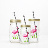 set of pink flamingo reusable water bottles with straws