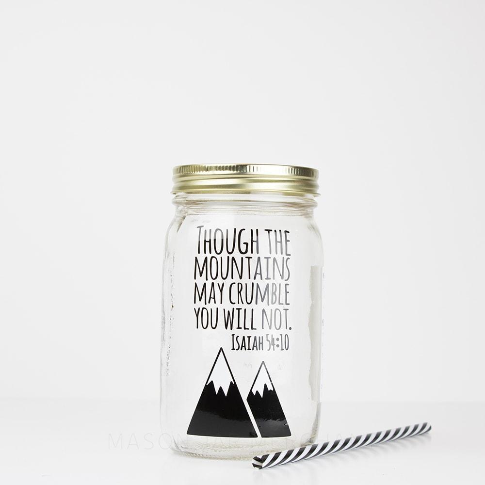 "Reusable glass mason jar water bottle with ""Though the mountains may crumble you will not, Isaiah 54:10"" text and mountain image.  With a black and white plastic straw against a white background"