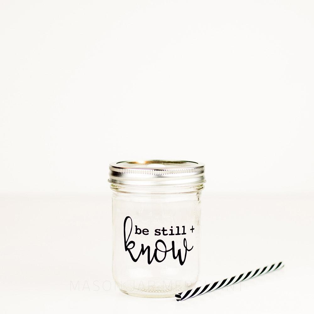 be still and know black typography design on a reusable water bottle with reusable straw