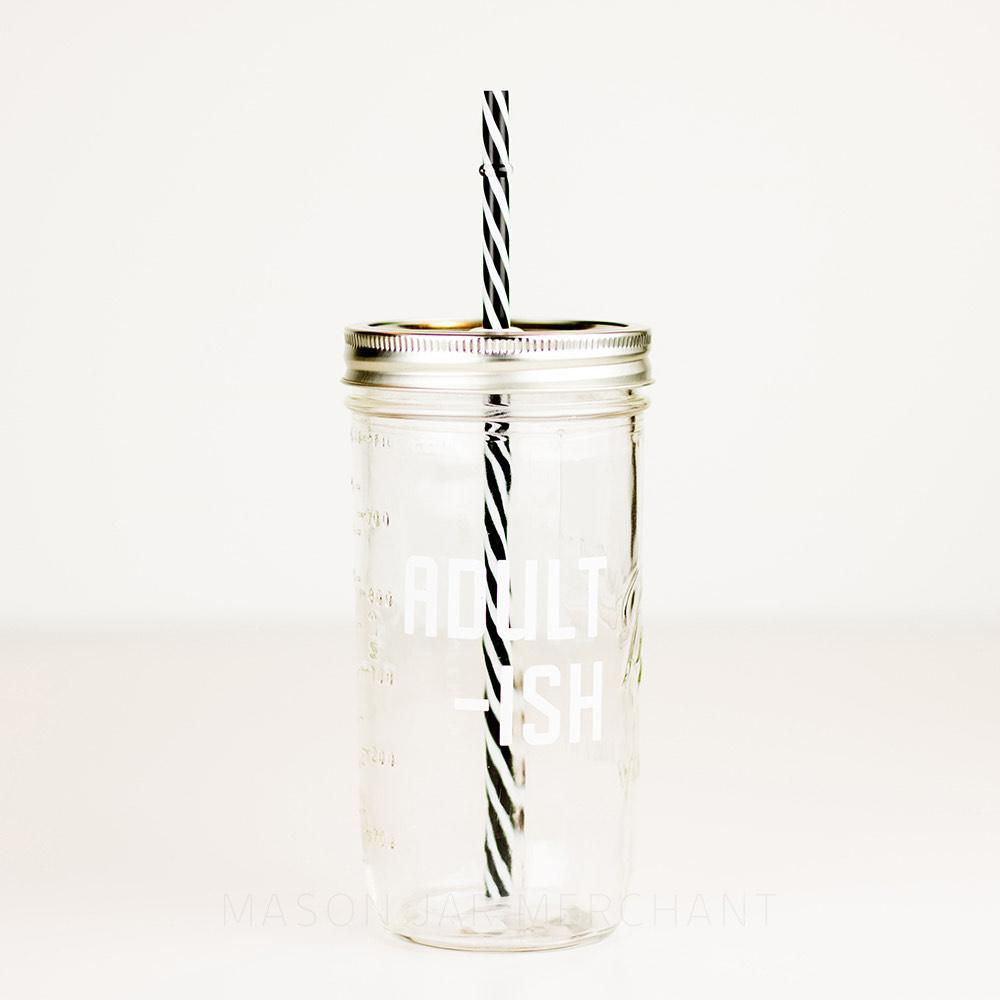 24 oz reusable glass mason jar tumbler with straw lid and reusable straw and block text that says adult-ish