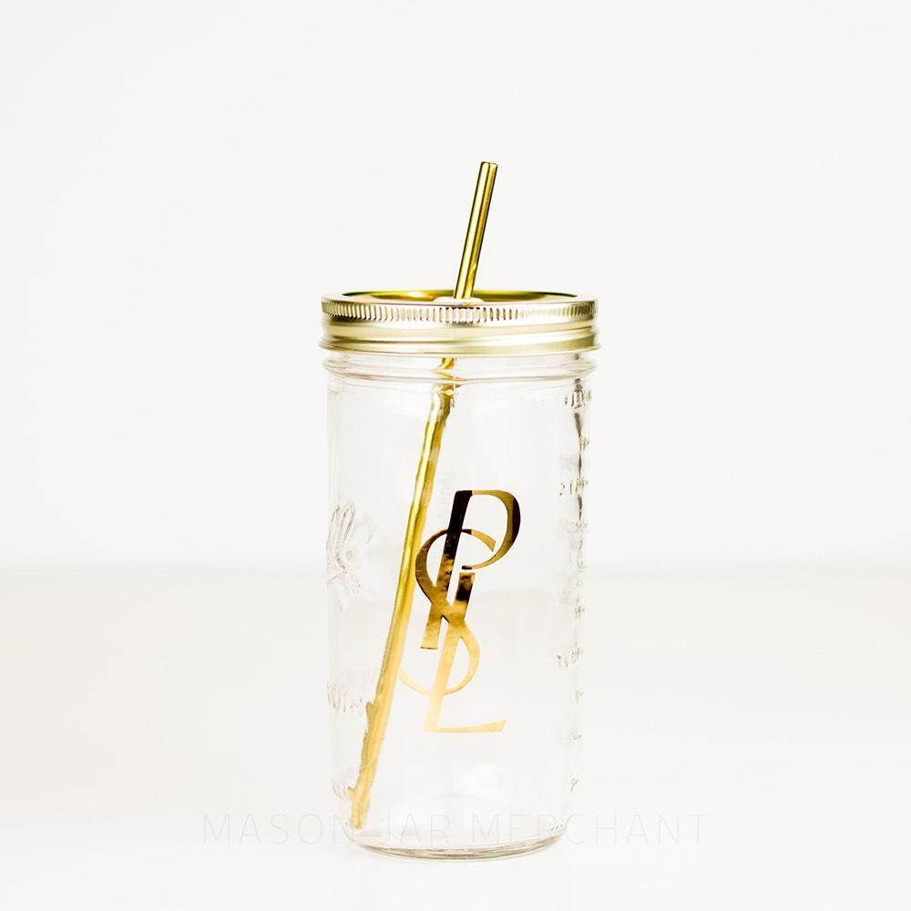 "24 oz glass reusable mason jar tumbler with a gold straw lid and a metal gold reusable straw. on the jar are the letters ""PSL"" one on top of the other in gold mirror text"