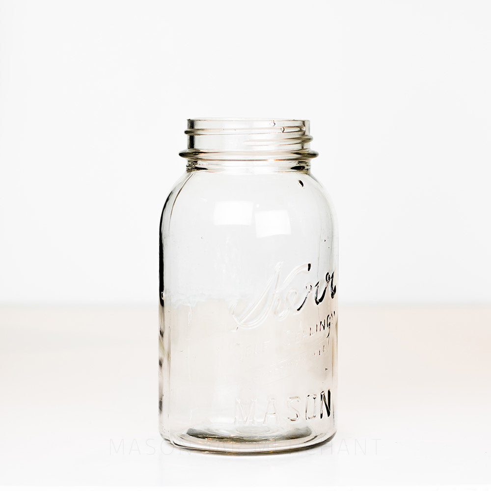 Side view of a vintage quart Kerr mason jar against a white background