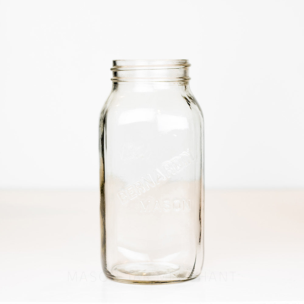 Regular mouth quart mason jar with Bernardin mason logo, on a white background