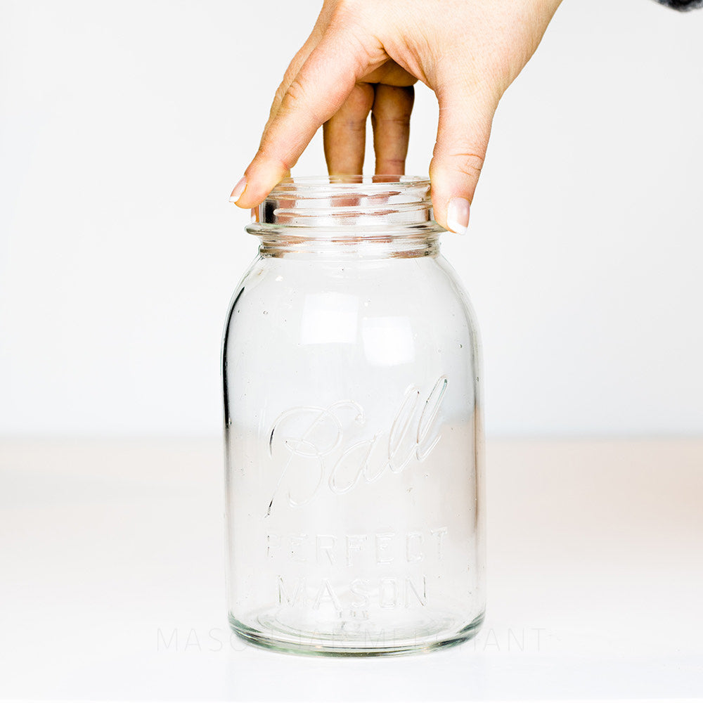 Vintage Ball regular mouth quart mason jar with Perfect Mason logo, on a white background