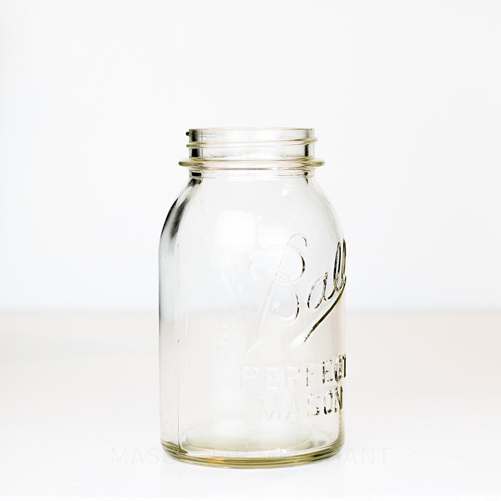 Vintage Ball regular mouth quart mason jar side view against a white background