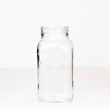 Dominion brand regular mouth mason jar on a white background
