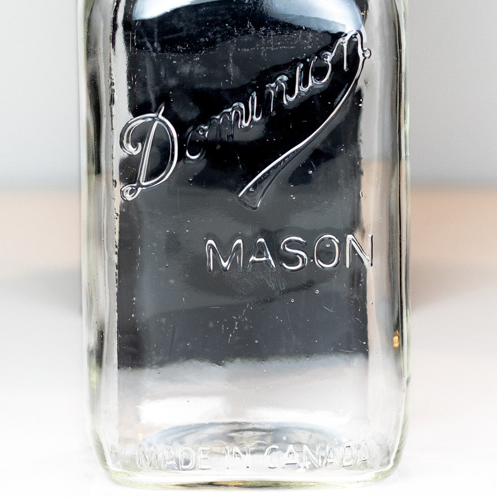 Close-up of a Dominion Mason logo on a quart mason jar