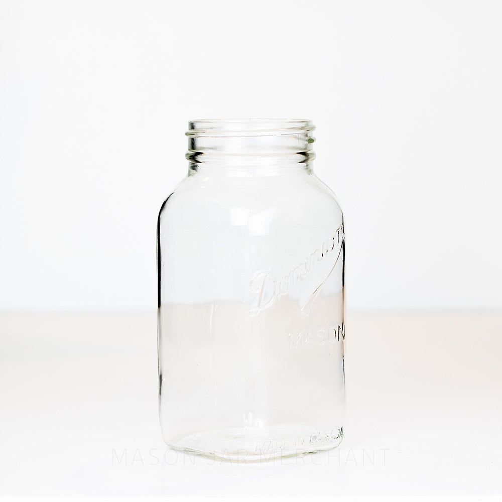 Side view of a Dominion Mason regular mouth quart jar against a white background