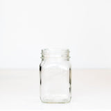 Regular mouth pint mason jar with Canadian Mason Jar, made in Canada logo, on a white background