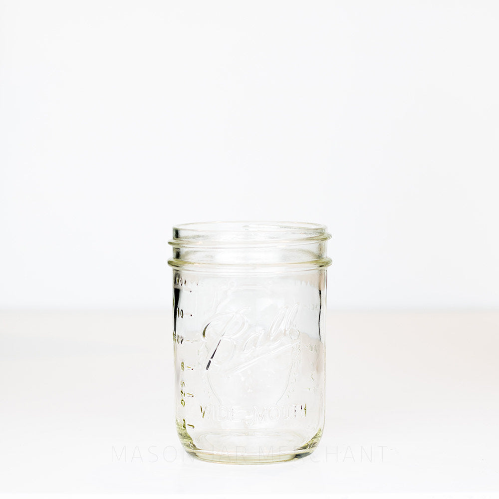 Ball wide mouth pint mason jar with logo showing, on a white background