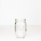 10 oz regular mouth mason jar with a unique tall and thin bulb shape, on a white background