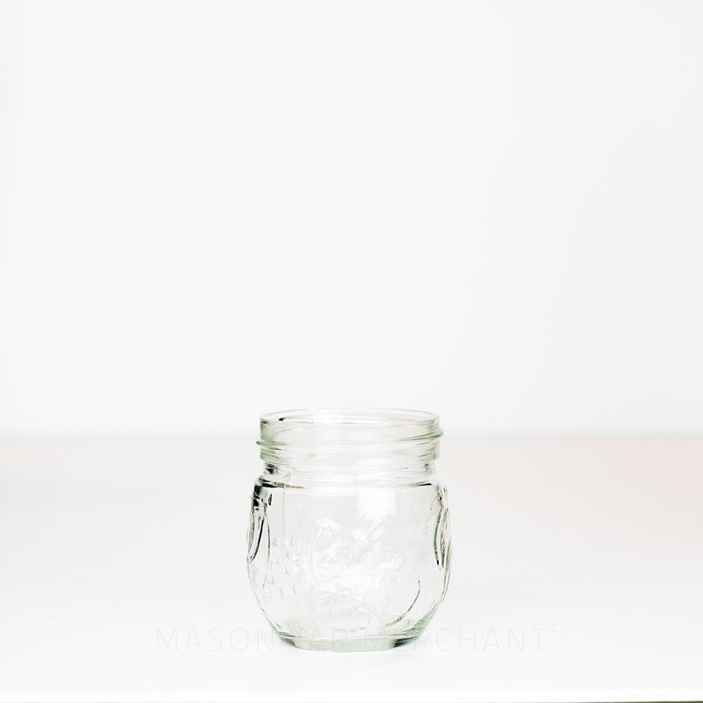 6.5 oz regular mouth mason jar with a unique bulb shape and a fruit pattern on a white background