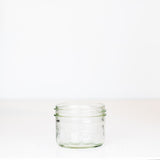Wide mouth half pint mason jar with Bernardin Mason logo against a white background