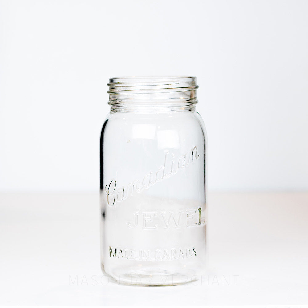 "Very old Vintage Canadian Jewel ""Made in Canada"" Gem Mouth Quart.  Has a single triangle marking on the bottom of the jar, photographed on a white background."