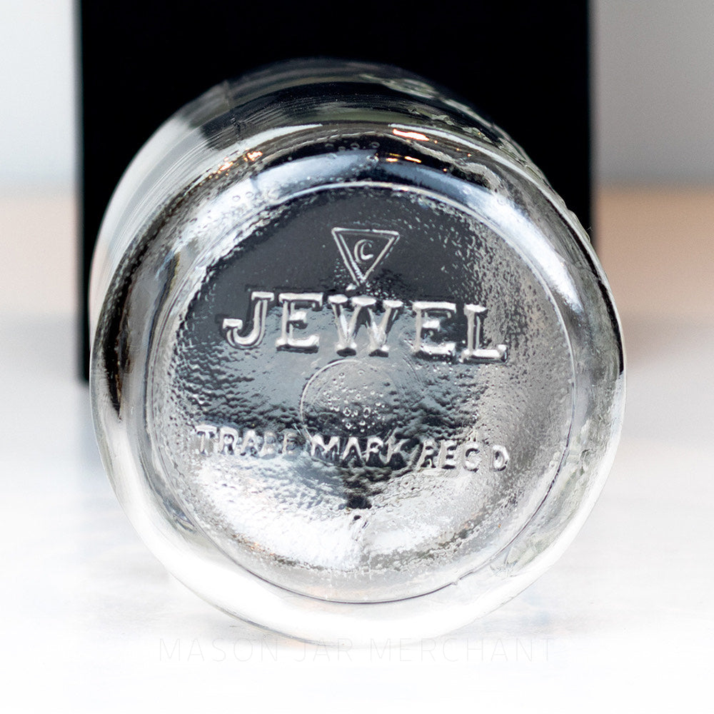 Close-up of a Jewel logo on the bottom of a vintage gem mouth mason jar