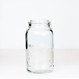 Vintage gem mouth quart mason jar with Improved Corona Jar logo, on a white background