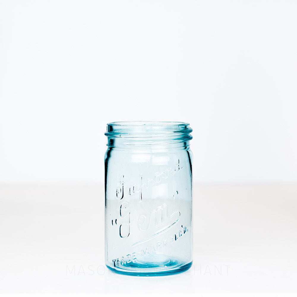 Vintage blue gem mouth pint mason jar with Improved Gem logo, on a white background