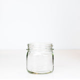Vintage Kerr Self Sealing Short Square Wide Mouth Pint Mason Jar on a white background.