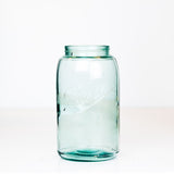 Vintage green-blue Ball regular mouth quart mason jar on a white background