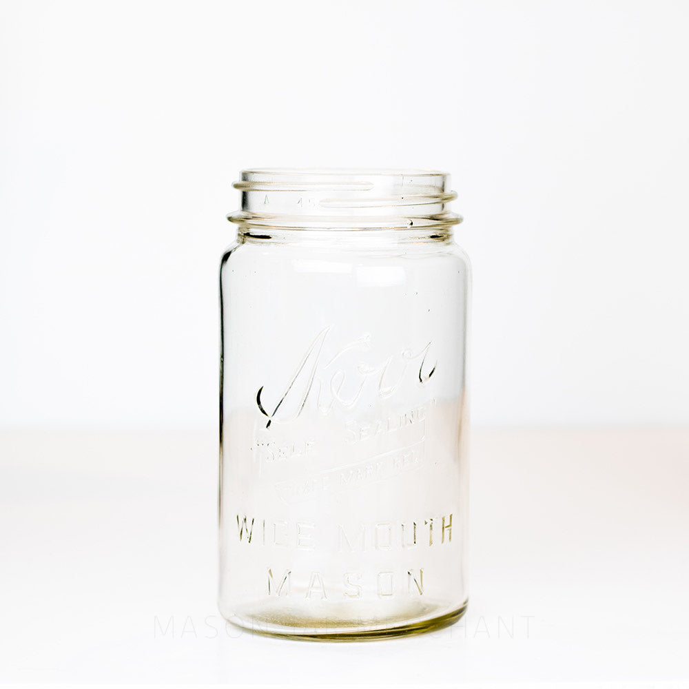 Vintage wide mouth quart mason jar with Kerr Wide mouth mason logo on a white background