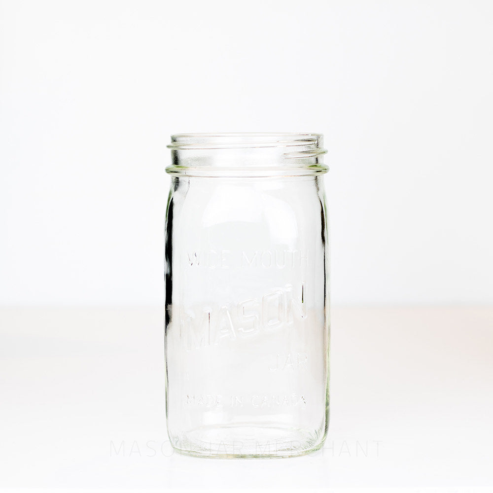 Wide mouth quart mason jar with Mason logo against a white background