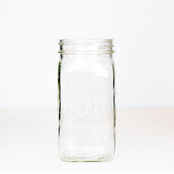 Wide mouth quart mason jar with Mason logo, against a white background
