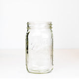 Wide mouth quart mason jar with Ball wide mouth logo on a white background