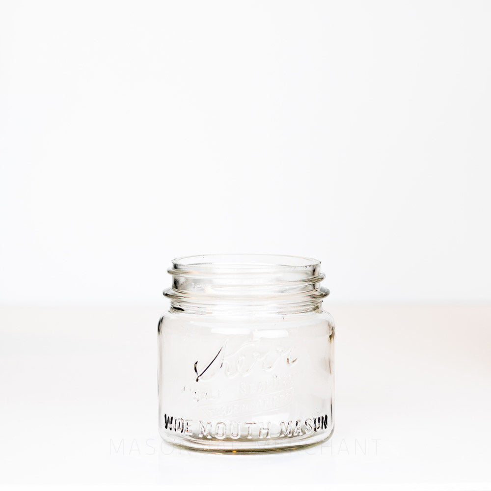 Short wide mouth pint mason jar with Kerr logo on a white background