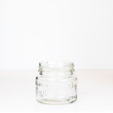 Vintage wide mouth pint mason jar with Canadian Sure Seal logo, against a white background
