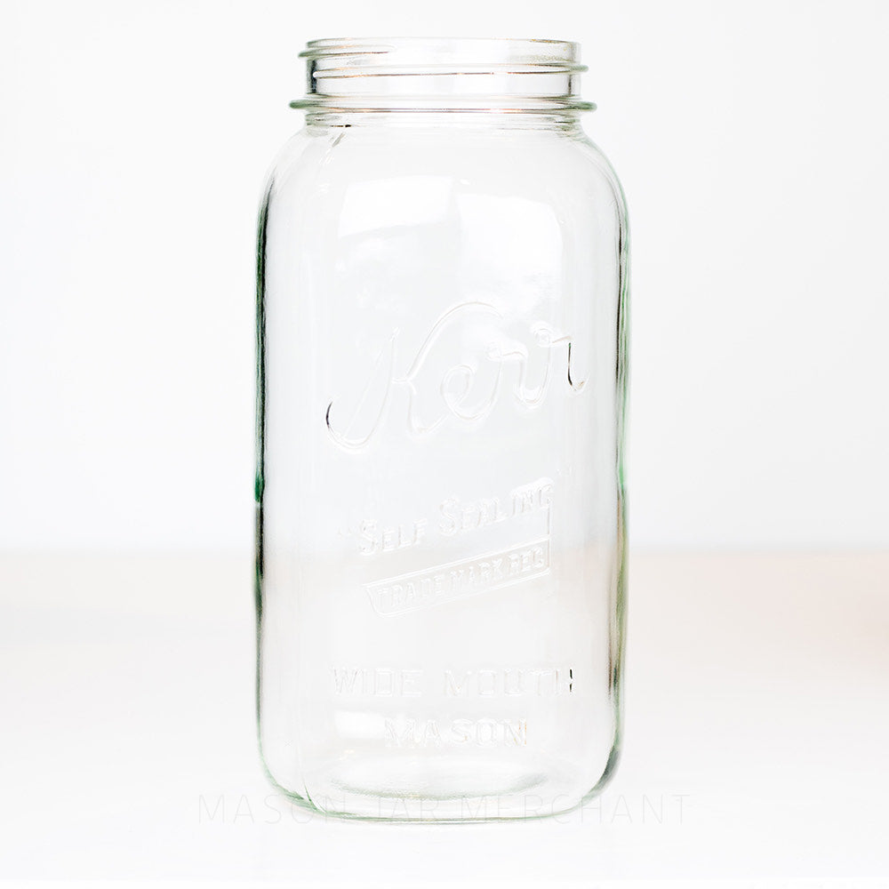 Wide mouth half-gallon mason jar with Kerr Self-sealing trade mark logo on a white background