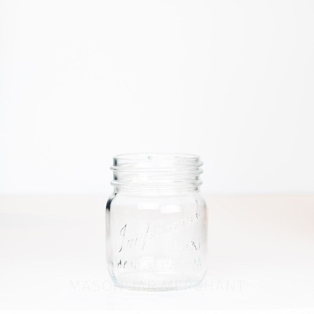 Adorable gem mouth 13 oz mason jar with Improved Gem logo on a white background