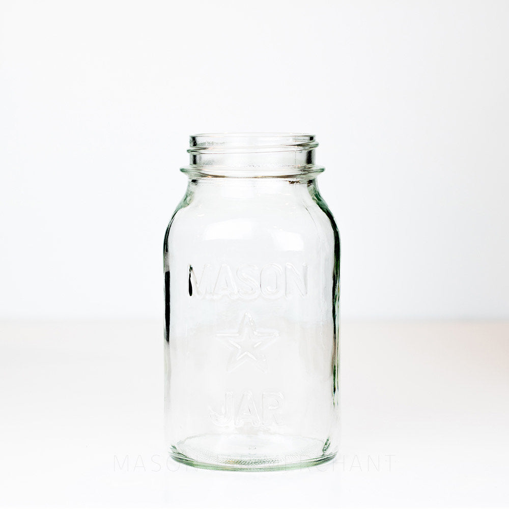 Regular mouth quart mason jar with a star and Mason Jar logo, against a white background