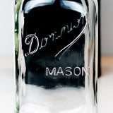 Close-up of Dominion Mason logo on a regular mouth quart mason jar