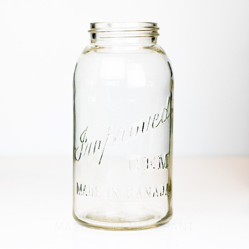 Gem mouth half gallon mason jar against a white background